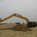 Excavator cu Brat Lung Caterpillar 385 second hand