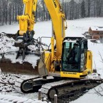Excavator pe senile New Holland E 230 second hand